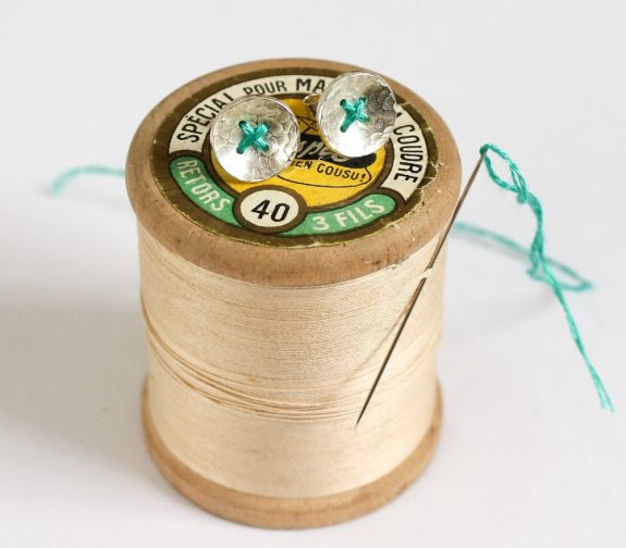 Stitched button earrings