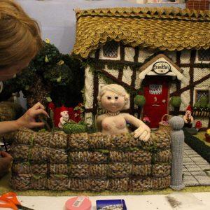 Sarah Simi working on a nudinits set